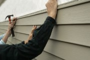 installing vinyl siding on a house