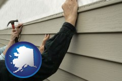 alaska map icon and installing vinyl siding on a house
