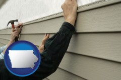 Iowa - installing vinyl siding on a house