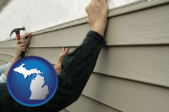 michigan map icon and installing vinyl siding on a house