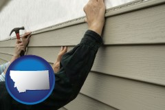 montana map icon and installing vinyl siding on a house