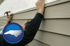 north-carolina map icon and installing vinyl siding on a house