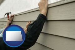 north-dakota map icon and installing vinyl siding on a house