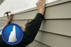 New Hampshire - installing vinyl siding on a house