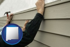 New Mexico - installing vinyl siding on a house