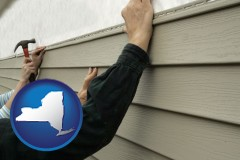 new-york map icon and installing vinyl siding on a house