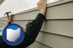 ohio map icon and installing vinyl siding on a house