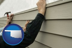 oklahoma map icon and installing vinyl siding on a house