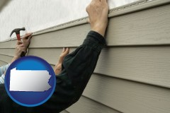 pennsylvania map icon and installing vinyl siding on a house