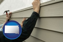 south-dakota map icon and installing vinyl siding on a house