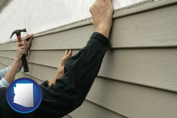 installing vinyl siding on a house - with Arizona icon