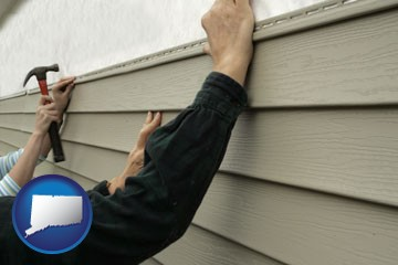 installing vinyl siding on a house - with Connecticut icon