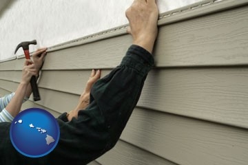 installing vinyl siding on a house - with Hawaii icon