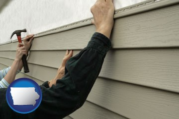 installing vinyl siding on a house - with Iowa icon