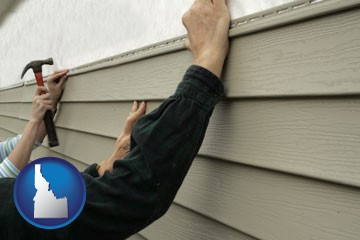 installing vinyl siding on a house - with Idaho icon