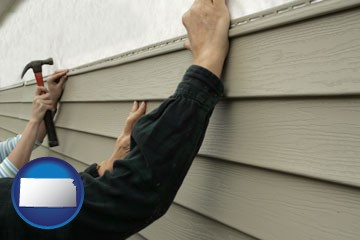 installing vinyl siding on a house - with Kansas icon