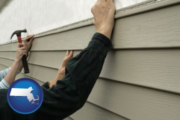 installing vinyl siding on a house - with Massachusetts icon