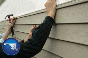 installing vinyl siding on a house - with Maryland icon