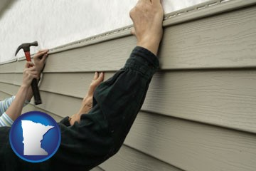 installing vinyl siding on a house - with Minnesota icon