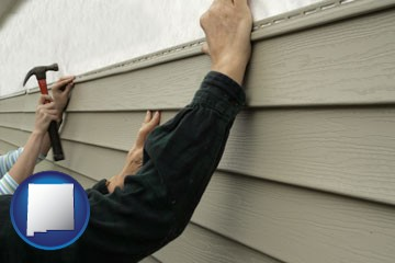 installing vinyl siding on a house - with New Mexico icon