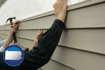 installing vinyl siding on a house - with Pennsylvania icon