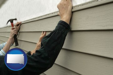 installing vinyl siding on a house - with South Dakota icon