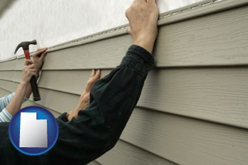installing vinyl siding on a house - with Utah icon