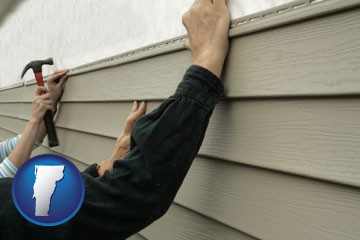 installing vinyl siding on a house - with Vermont icon