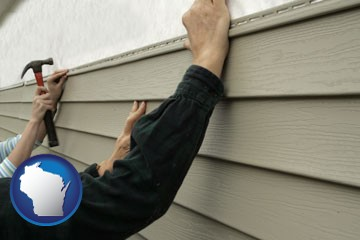 installing vinyl siding on a house - with Wisconsin icon