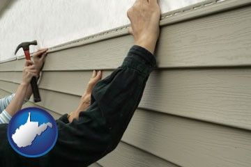 installing vinyl siding on a house - with West Virginia icon